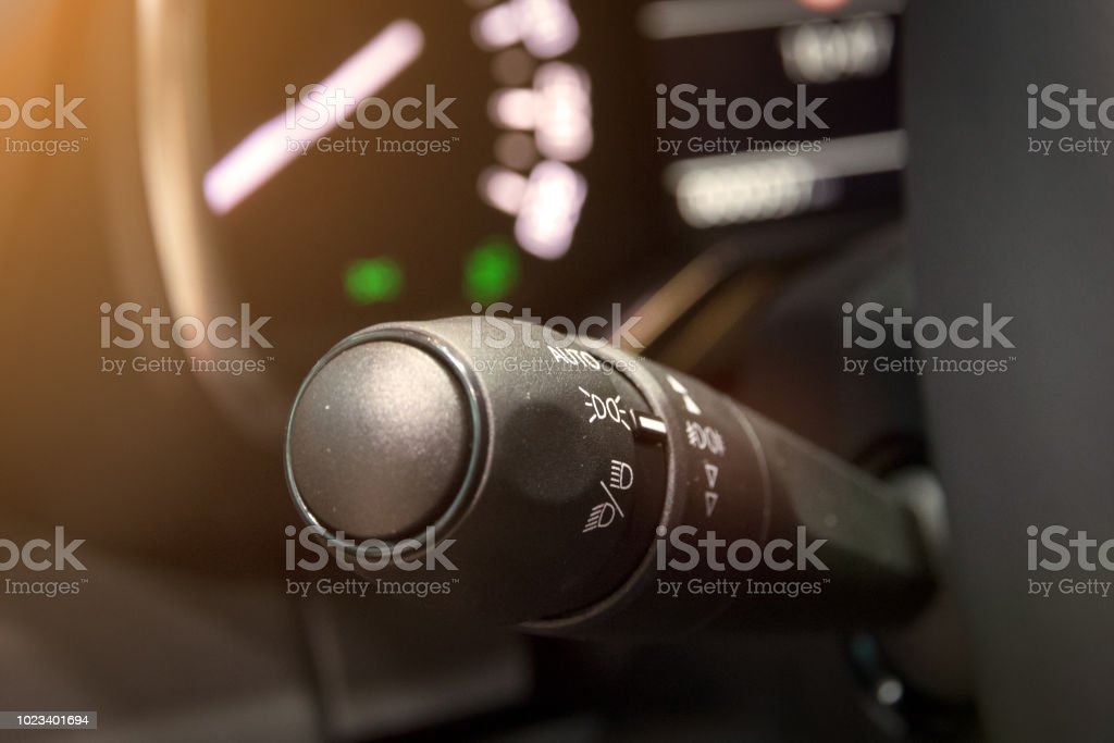 close up of car light and signal switch and control.