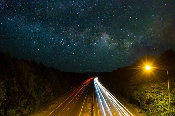 Car Light Trails and Sky at Night stock photo