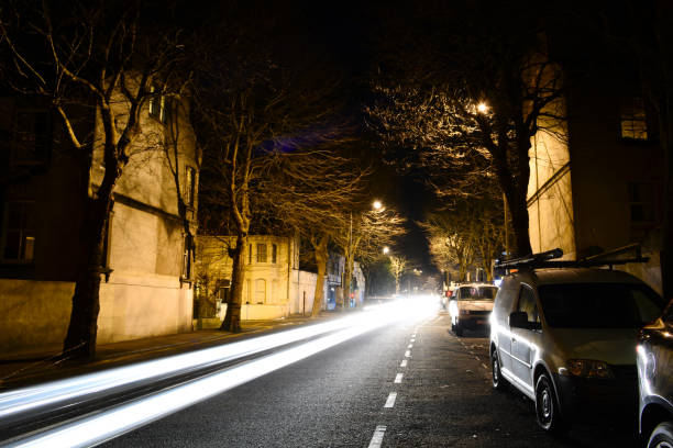 car light trails in brighton - dotted line stock photos and pictures