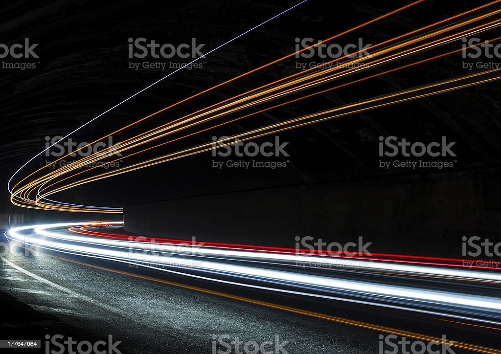 Car light trails in the tunnel royalty-free stock photo