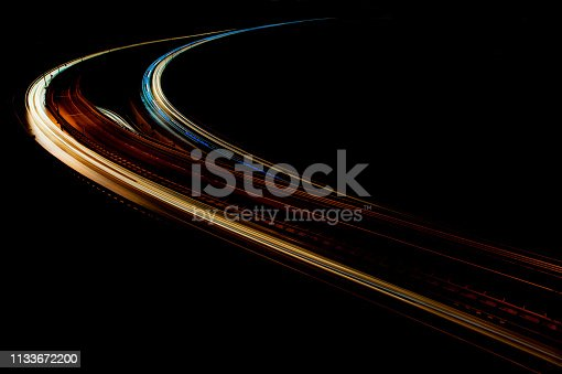 Car Light trails on the intersection road in istanbul, abstract long exposure traffic lights. blur motion of cars on the city road at night