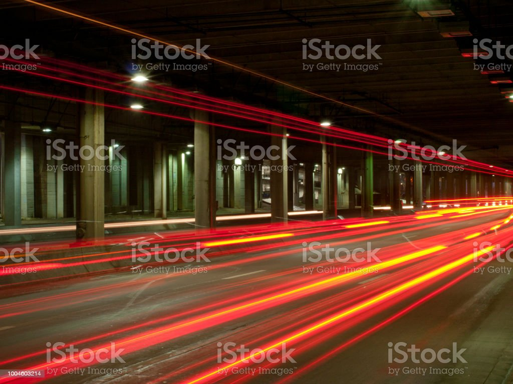 A 30 second exposure at rush hour of car lights in a tunnel.