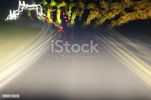 istock Car lights on the streets at night and blurry. 696816928