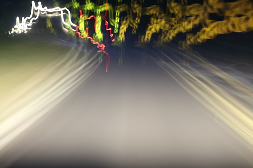 824108398 istock photo Car lights on the streets at night and blurry. 696816928