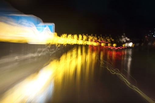 824108398 istock photo Car lights on the streets at night and blurry. 697979618