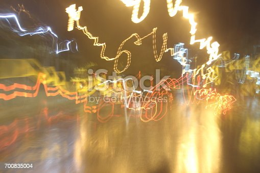 istock Car lights on the streets at night and blurry. 700835004
