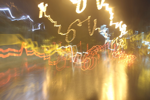 824108398 istock photo Car lights on the streets at night and blurry. 700835004