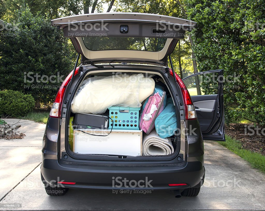 Car loaded for college move in stock photo