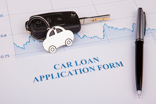 512011833 istock photo Car loan application form lay down on desk 1221507772