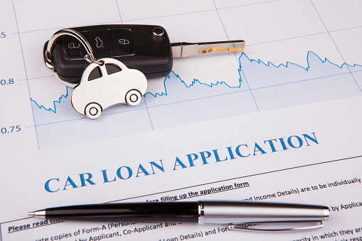 512011833 istock photo Car loan application form lay down on desk 943963542