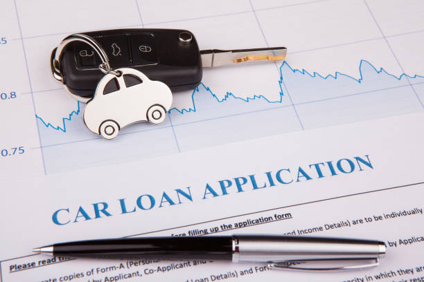 Car loan application form lay down on desk stock photo