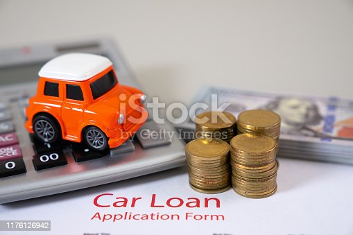 istock Car loan,money,car insurance application form 1176126942