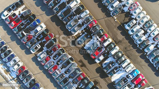 133277230 istock photo Car lot, in Springtime, many vehicles for sale, aerial view. 936302858