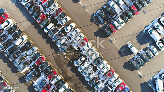 133277230 istock photo Car lot, in Springtime, many vehicles for sale, aerial view. 936302922