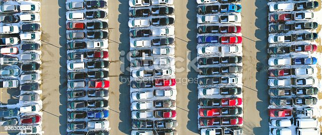 133277230 istock photo Car lot, in Springtime, many vehicles for sale, aerial view. 936302940