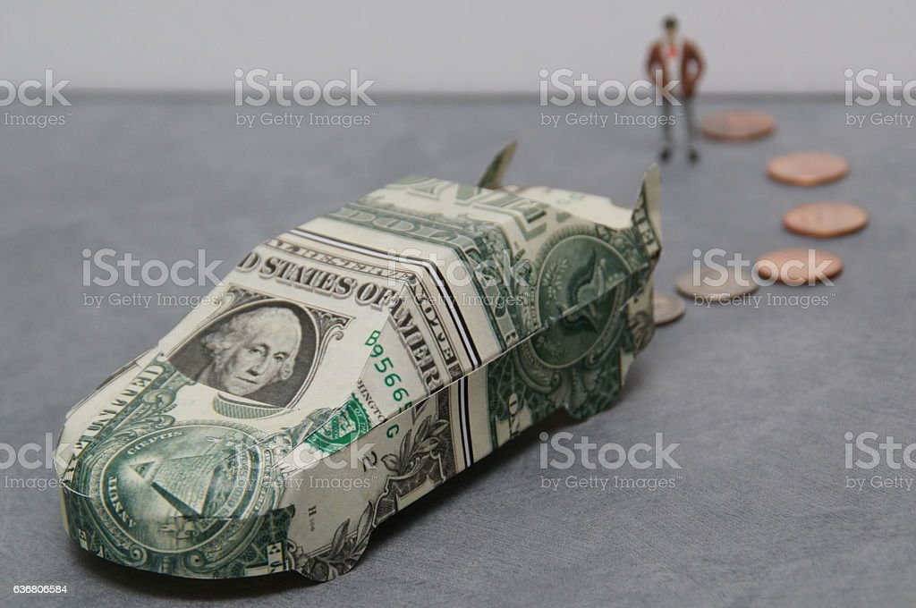 car made of dollers with coins stock photo