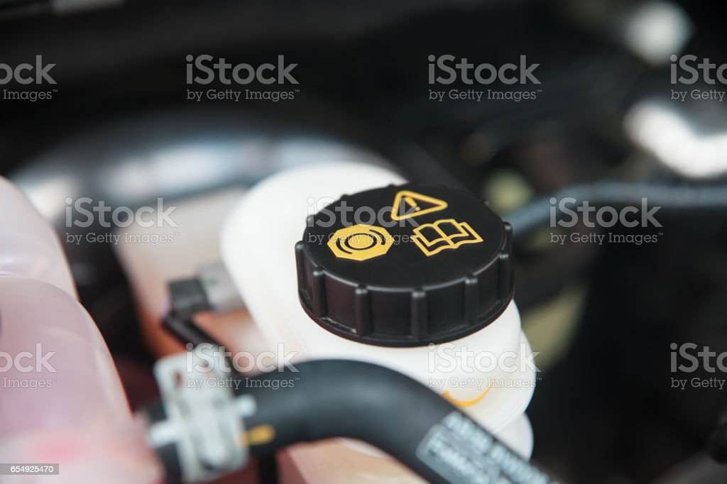 Car maintenance and check the level of brake and clutch fluid. stock photo