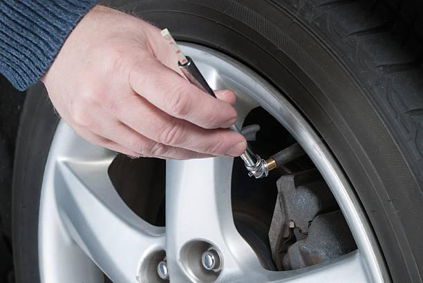 Car Maintenance - Check Tire Air Pressure stok fotoğrafı