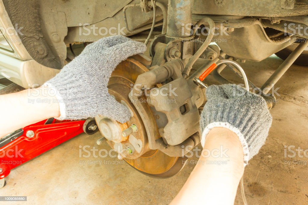 Car maintenance service, Use 8 mm. Wrench to change brake fluid. Auto mechanic check and maintenance brake system. stock photo