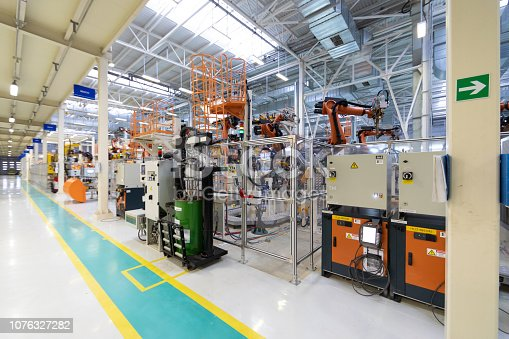 1069360792 istock photo Car manufacturing plant. Automotive shop. The Assembly line for manufacturing cars. 1076327282