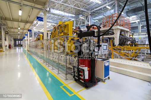 1069360792 istock photo Car manufacturing plant. Automotive shop. The Assembly line for manufacturing cars. 1079938580
