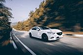 Car Mazda driving on road at daytime
