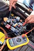 istock Car mechanic at work 1219594565