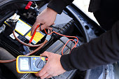istock Car mechanic at work 1219594578