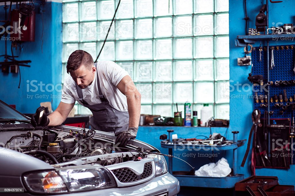 Car mechanic at work stock photo