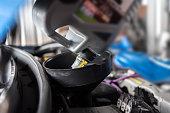 istock Car mechanic fills a fresh lubricant engine oil 1057452906
