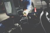 istock Car mechanic fills a fresh lubricant engine oil 1065814336