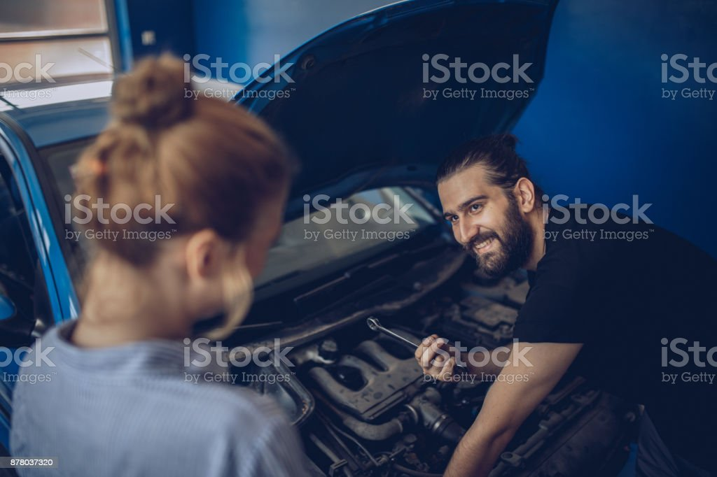 Car mechanic helping customer stock photo
