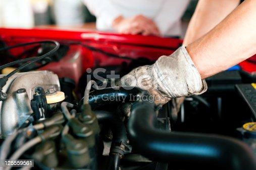 136591855 istock photo Car mechanic in repair shop 125559561