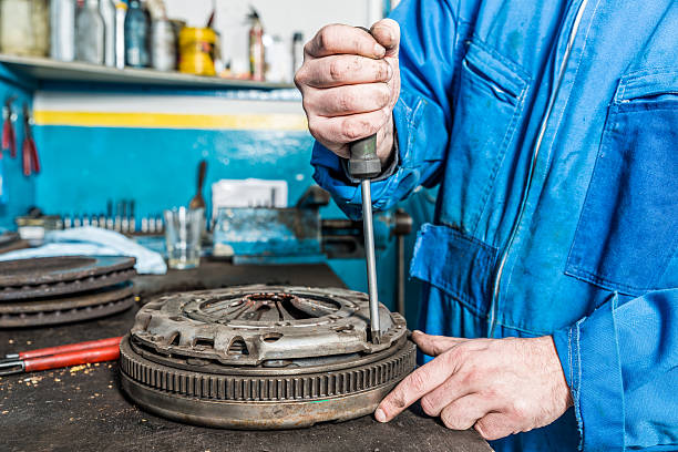 Car mechanic is changing Clutch Car mechanic is changing Clutch vehicle clutch stock pictures, royalty-free photos & images