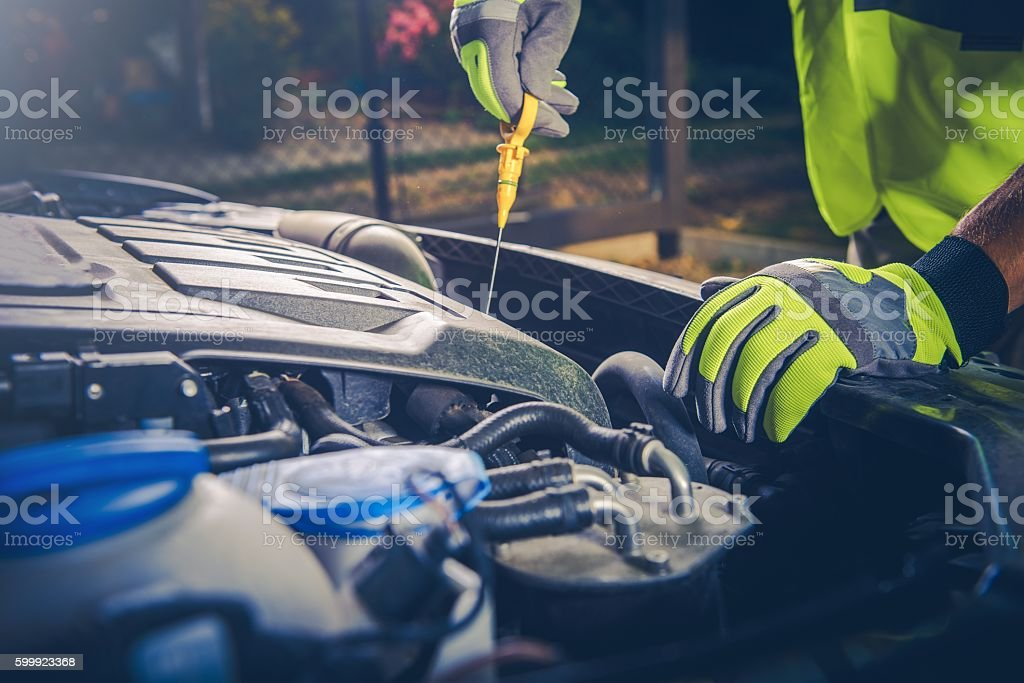 Car Mechanic Oil Check stock photo