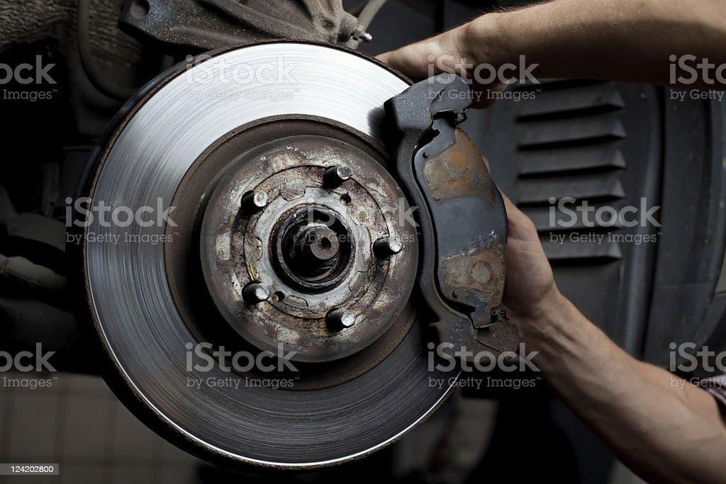 Car mechanic repair brake pads stock photo