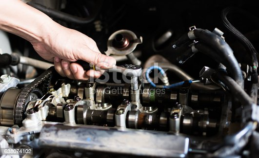 1073743202 istock photo Car mechanic repairing an internal combustion engine. 638074102