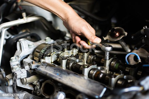 1073743202 istock photo Car mechanic repairing an internal combustion engine. 638074128