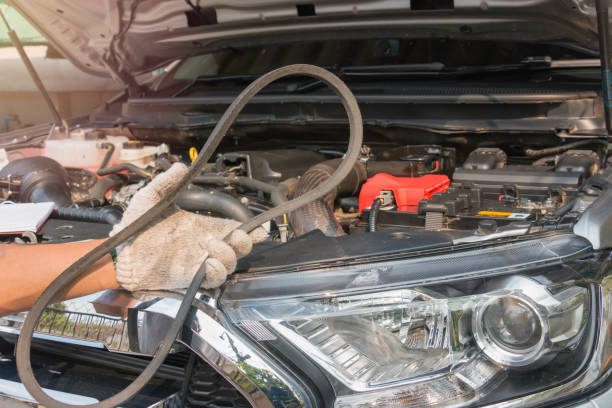 car mechanic replacing timing belt - belt stock photos and pictures