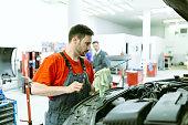 istock Car mechanic upkeeping car 543044582