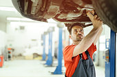istock Car mechanic upkeeping car 543448944