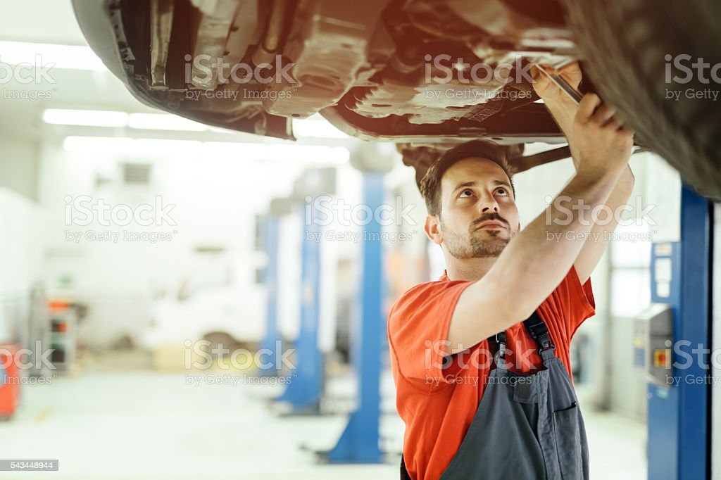 Car mechanic upkeeping car stock photo