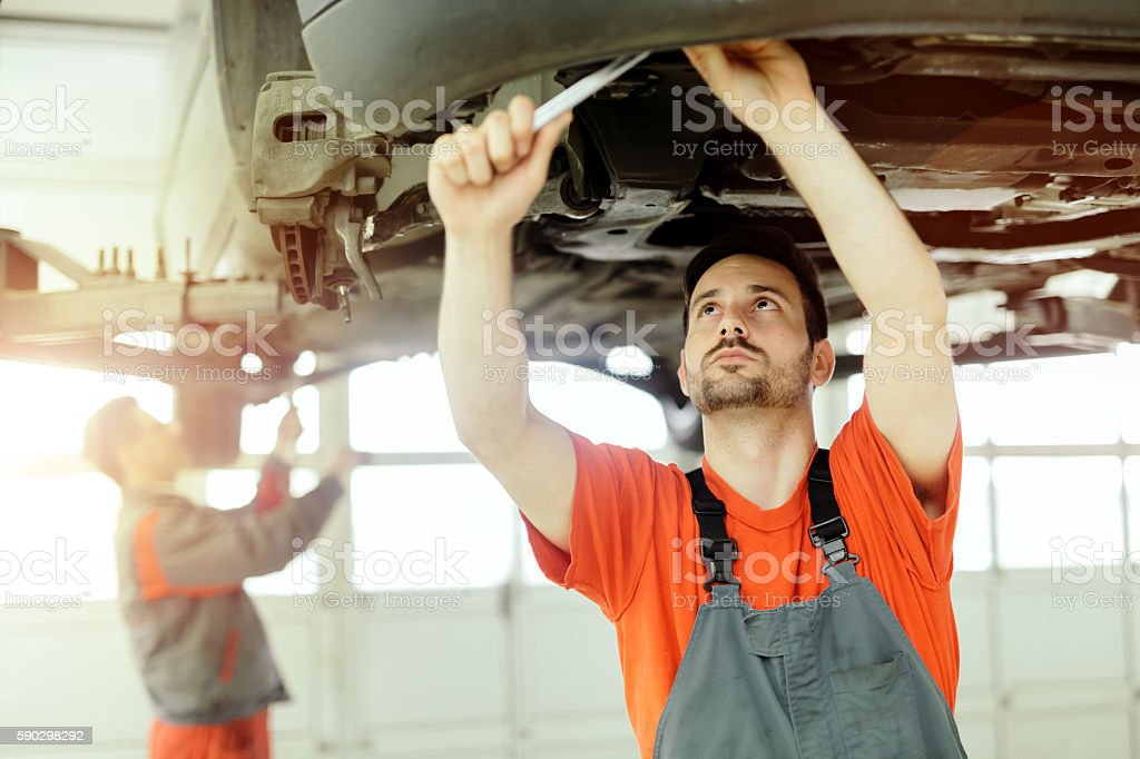 Car mechanic upkeeping car Стоковые фото Стоковая фотография