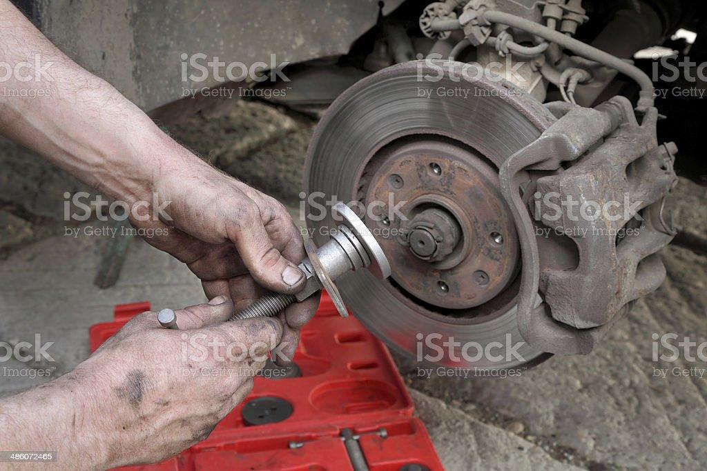 Car mechanic work on disc brakes stock photo