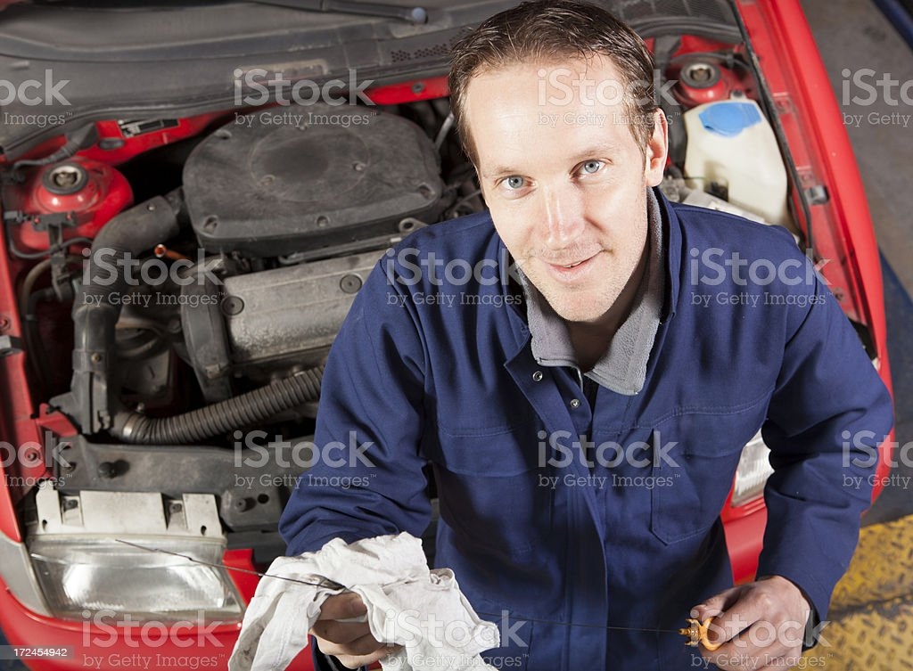 Car mechanic working in auto repair service royalty-free stock photo