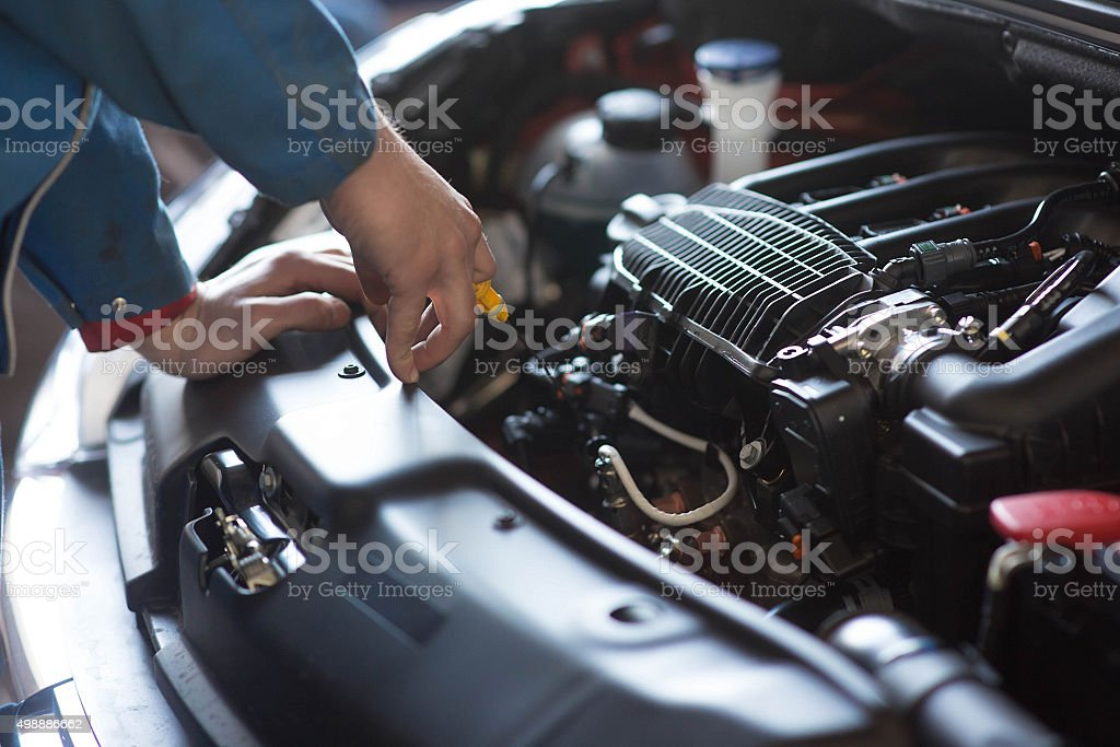 Car mechanic working in auto repair service stock photo