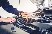 istock Car mechanic working in auto repair service 697961204