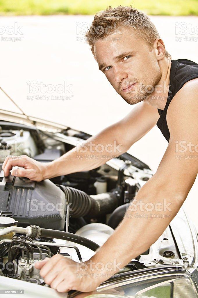 Car mechanician repairs engine royalty-free stock photo