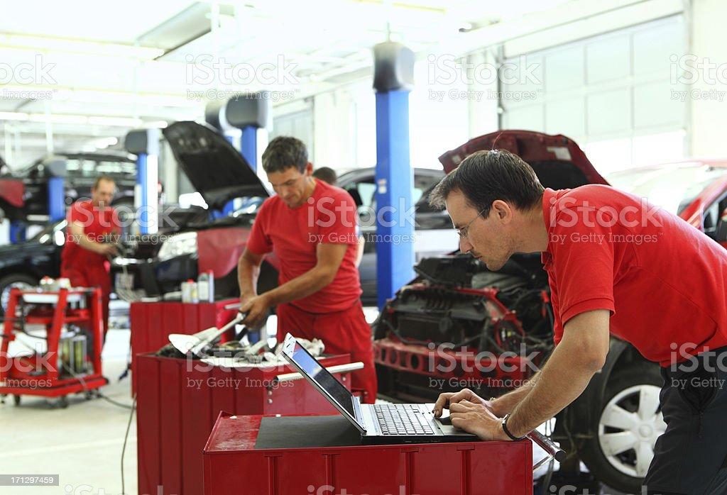 Car mechanics at work. royalty-free stock photo