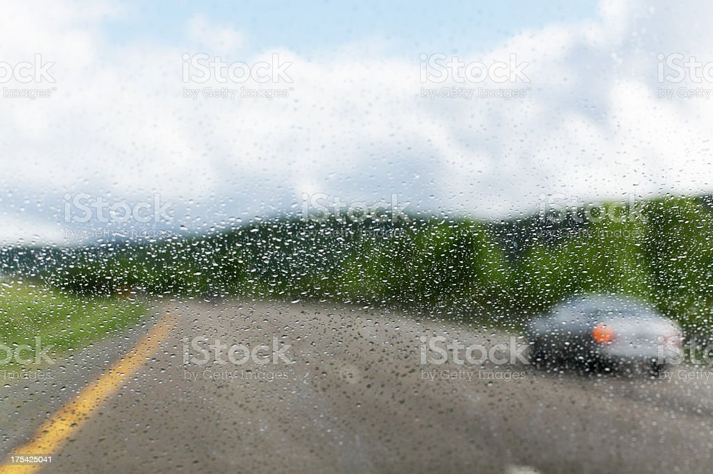 Car Merging Ahead in Driving Rain royalty-free stock photo